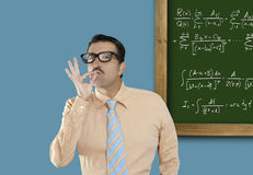 Mathematical formula genius nerd geek easy resolve. Genius nerd easy found the solution of a mathematical formula in blackboard Stock Images