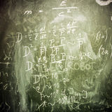 Mathematical formulas on a green school board as background Stock Image