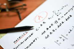 Mathematical formulas written on a white paper Stock Images