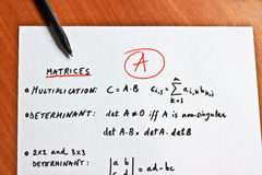 Mathematical formulas written on a white paper royalty free stock image