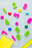 Mathematical numeral and English Latin letters of alphabet colored pencils. On drawing board in cage Concept of learning to write and read Back to School Royalty Free Stock Photo