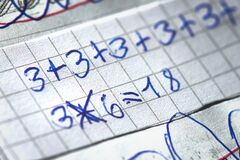 Mathematical operations at school written by a child