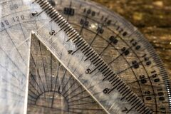 Mathematical rulers on aged weathered pine wood boards close up macro shot