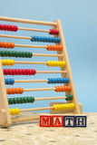 Mathematics. A childs abacus and alphabet blocks to represent the subject of learning math Stock Images
