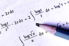 Mathematics. Calculations - with pencil. The focus is on the pencil tip - blue color Royalty Free Stock Photos