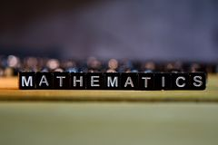 MATHEMATICS concept wooden blocks on the table. royalty free stock image