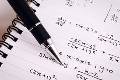 Mathematics or Equations close-up. Homework. Solving Mathematical Problem. Stock Photo