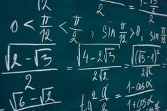 Mathematics formulas written on the blackboard. School, education. royalty free stock photo