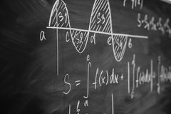 Mathematics function integra graph formulas on the chalkboard. Mathematics function integra graph formulas on the chalkboard royalty free stock image