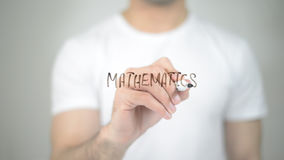 Mathematics, man writing on transparent screen royalty free stock images