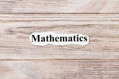 Mathematics Of The Word On Paper. Concept. Words Of Mathematics On A Wooden Background Royalty Free Stock Photography