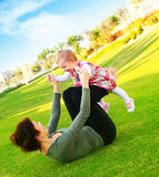 Mather & baby daughter playing Royalty Free Stock Photo