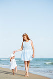 Mather and baby on the ocean beach Royalty Free Stock Images