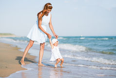 Mather and baby on the ocean beach Stock Photo