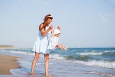 Mather and baby on the ocean beach Stock Photography