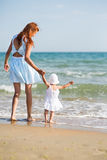 Mather and baby on the ocean beach Stock Photos