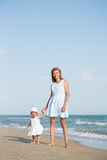 Mather and baby on the sea Stock Photos