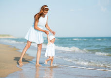Mather and baby on the sea Royalty Free Stock Photo