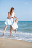 Mather and baby on the sea Stock Image