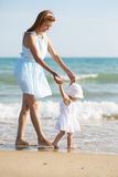 Mather and baby on the sea Stock Images