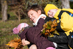 Mather and children in park Royalty Free Stock Images