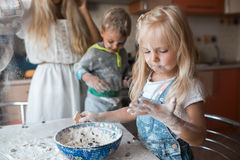 Mather daughter and son haveing fun on a kitchen. Mather have fun with kids on kitchen Stock Photos