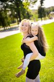 Mather and her daughter in the park. royalty free stock photography