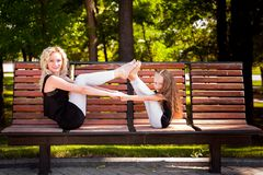 Mather and her daughter in the park. stock photo