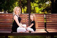 Mather and her daughter in the park. royalty free stock image