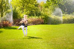 Mather and her daughter in the park. stock images