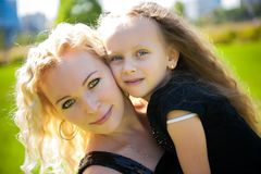 Mather and her daughter in the park. stock photos