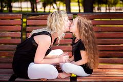 Mather and her daughter in the park. royalty free stock photos