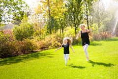 Mather and her daughter in the park. stock image