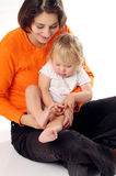Mather in orange T-shirt with little blonde girl Royalty Free Stock Image