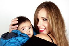Mather and Son. A blond young lady and her son Royalty Free Stock Photography
