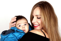 Mather and Son. A blond young lady and her son Royalty Free Stock Photos