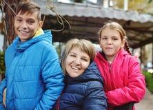 Ordinary family outdoors stock photo