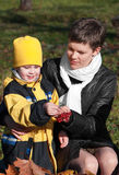 Mather and son in park. Happy mather and son in park Royalty Free Stock Photos