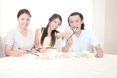 Mather and a young couple having dinner royalty free stock images