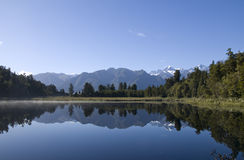 Matheson Lake Reflection. Reflection of Mount Cook  in Lake Matheson on a clear Blue day Stock Photo