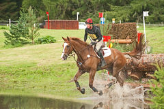 Mathew Heath riding for Great Britain. Matthew Heath in the water after jumping the log  in the cross country at Blair Castle International Horse trial on 25th Royalty Free Stock Images