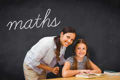 Maths against blackboard. The word maths and female teacher and little girl in library against blackboard Royalty Free Stock Photos