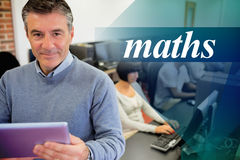 Maths against teacher holding a tablet pc Royalty Free Stock Photo