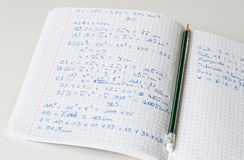 Maths exercise-book. Maths exercisebook with pencil on a white table Royalty Free Stock Image