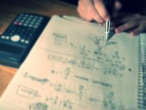 Maths notes. View of a man studing maths Royalty Free Stock Photo