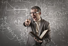 Maths teacher pointing at someone Stock Photography