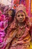 Holi celebration, Vrindavan and Mathura, India. Mathura, India - March 23, 2016: Indian children dressed as Hindu deities participate during colourful Holi stock photos