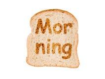 Matin de Word écrit sur une tranche de pain grillée Photo stock