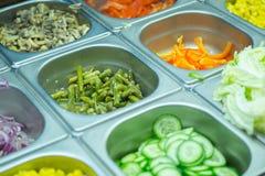 Matingredienser i ställer ut arkivbild