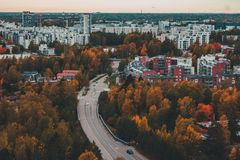Matinkylä in the autumn with trees and houses, Espoo Finland. Urban view of Matinkylä in the autumn with color full trees and apartment houses, Espoo stock photography